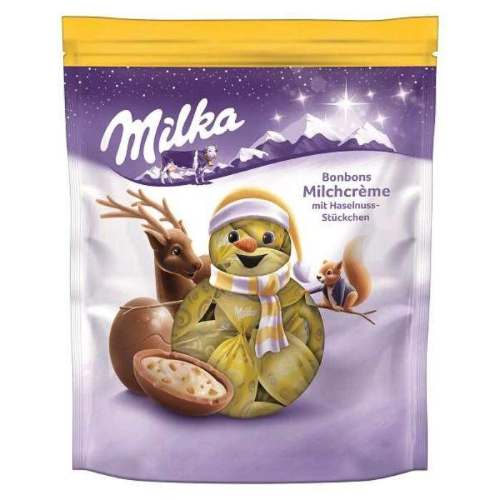 Milka  Karácsonyi Tejkrémes Golyók Mogyoródarabokkal 86g